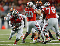 Ohio State Buckeyes quarterback J.T. Barrett (16) looks for an opening as he keeps the ball in the first quarter the college football game between the Ohio State Buckeyes and the Illinois Fighting Illini at Ohio Stadium in Columbus, Saturday night, November 1, 2014. The Ohio State Buckeyes defeated the Illinois Fighting Illini 55 - 14. (The Columbus Dispatch / Eamon Queeney)