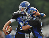Kyle Tiernan #12, Glenn quarterback, left, gets congratulated by teammate Anthony Tesi #2 after running for a touchdown in the second quarter of a Suffolk County Division IV varsity football game against Mount Sinai at Glenn High School on Saturday, Sept. 10, 2016.
