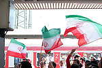 11 June 2006: Iran fans waive flags while waiting for a train to the game. Mexico played Iran at the Frankenstadion in Nuremberg, Germany in match 7, a Group D first round game, of the 2006 FIFA World Cup.