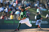 Relief pitcher Devon Fisher (44) of the Greenville Drive delivers a pitch in a game against the Charleston RiverDogs on Sunday, April 29, 2018, at Fluor Field at the West End in Greenville, South Carolina. Greenville won, 2-0. (Tom Priddy/Four Seam Images)