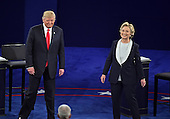 Former United States Secretary of State Hillary Clinton, the Democratic Party nominee for President of the US and businessman Donald J. Trump, the Republican Party candidate for President of the US, arrive on stage to begin the second of three presidential general election debates at Washington University in St. Louis, Missouri on Sunday, October 8, 2016.<br /> Credit: Ron Sachs / CNP