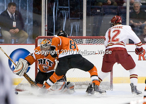 Jared DeMichiel (RIT - 33), Chris Tanev (RIT - 8), Joe Colborne (Denver - 12) - The Rochester Institute of Technology (RIT) Tigers defeated the Denver University Pioneers 2-1 on Friday, March 26, 2010, in their NCAA East Regional semi-final at the Times Union Center in Albany, New York.