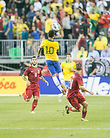 Brazil forward Neymar (10) leaps to a head ball as Portugal midfielder Vieirinha (11) stands by.  In an International friendly match Brazil defeated Portugal, 3-1, at Gillette Stadium on Sep 10, 2013.