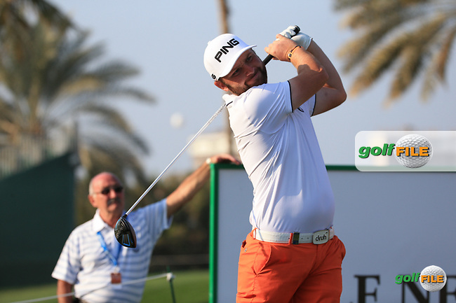 Watched by father Terry, Andy Sullivan (ENG) drives the 13th during the Pro-Am at the 2016 Omega Dubai Desert Classic, played on the Emirates Golf Club, Dubai, United Arab Emirates.  03/02/2016. Picture: Golffile   David Lloyd<br /> <br /> All photos usage must carry mandatory copyright credit (&copy; Golffile   David Lloyd)