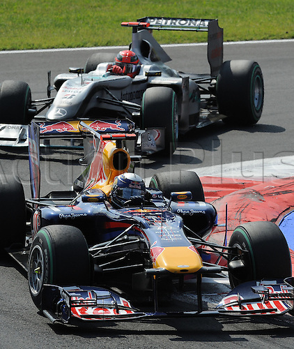German driver Sebastian Vettel of Red Bull drives ahead of German driver Michael Schumacher of Mercedes GP during the 2010 Formula One Italian Grand Prix at the Autodromo Nazionale in Monza, Italy.