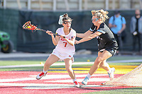 College Park, MD - April 27, 2019: Maryland Terrapins attack Catie May (7) looks to pass the ball during the game between John Hopkins and Maryland at  Capital One Field at Maryland Stadium in College Park, MD.  (Photo by Elliott Brown/Media Images International)
