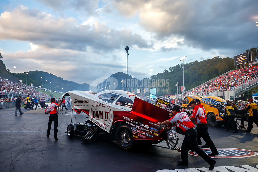 Jun 16, 2017; Bristol, TN, USA; Crew members for NHRA funny car driver Cruz Pedregon during qualifying for the Thunder Valley Nationals at Bristol Dragway. Mandatory Credit: Mark J. Rebilas-USA TODAY Sports