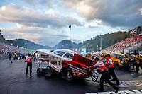 Jun 16, 2017; Bristol, TN, USA; Crew members for NHRA funny car driver Cruz Pedregon during qualifying for the Thunder Valley Nationals at Bristol Dragway. Mandatory Credit: Mark J. Rebilas-USA TODAY Sports