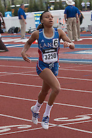 Former Francis Howell state champion and University of Kansas freshman Whitney Adams crosses the finish line first in her section in the 400-meter dash in 55.15 to give her a seventh-place finish overall.
