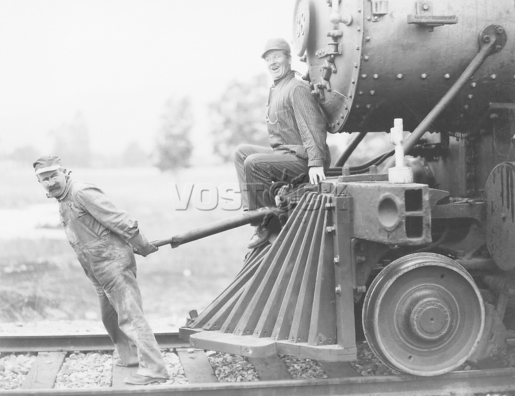 Engineers pulling train engine