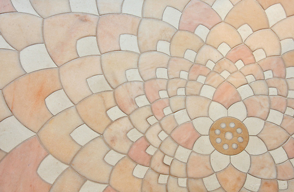 Ever Expanding Lotus, a stone waterjet mosaic shown in honed Rosa Portagallo, Ivory Cream, and Jerusalem Gold is by Tucker Robbins for New Ravenna Mosaics.