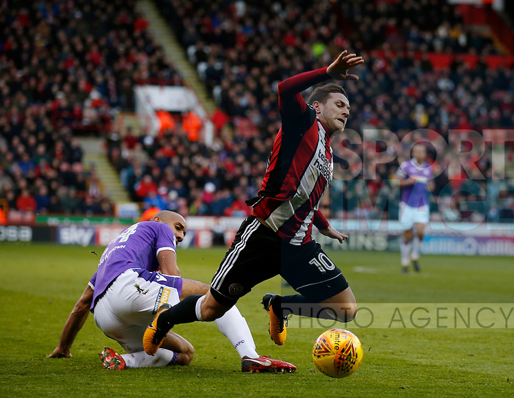 Billy Sharp of Sheffield Utd brought down by Karl Henry of Bolton Wanderers during the Championship match at Bramall Lane Stadium, Sheffield. Picture date 30th December 2017. Picture credit should read: Simon Bellis/Sportimage
