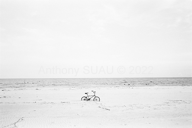 Long Beach, Mississippi.USA.July 30, 2006..A bicycle stuck in the sand after being hit by hurricane Katrina one year ago....