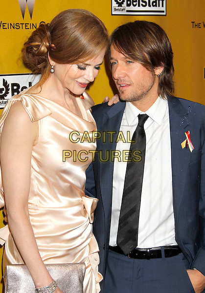 NICOLE KIDMAN & KEITH URBAN.Weinstein Company Post Golden Globe Party held at Bar210 & Plush Ultra Lounge at the Beverly Hilton Hotel, Beverly Hills, California, USA..January 17th, 2009.globes half length pink beige silk satin dress clutch bag gathered cream beige maxi profile black blue suit married husband wife.CAP/ADM/MJ.©Michael Jade/Admedia/Capital Pictures