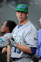 Third baseman Hunter Dozier (13) of the Lexington Legends before a game against the Greenville Drive on Friday, August, 16, 2013, at Fluor Field at the West End in Greenville, South Carolina. Dozier was the No. 1 pick (eighth overall) by the Kansas City Royals in the first round of the 2013 First-Year Player Draft. He played collegiate ball for Stephen F. Austin University. Greenville won, 2-1. (Tom Priddy/Four Seam Images)