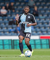 Janoi Donacien of Wycombe Wanderers plays a pass during the Sky Bet League 2 match between Wycombe Wanderers and Hartlepool United at Adams Park, High Wycombe, England on 5 September 2015. Photo by Andy Rowland.