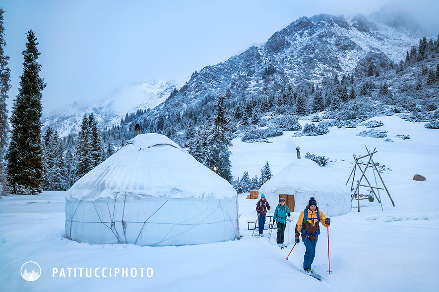 A group of ski tourers leave their yurt camp in the Aksuu Valley, Kyrgyzstan