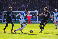 Huddersfield Town's forward Collin Quaner (23) turns inside Crystal Palace's midfielder Luka Milivojevic (4) during the EPL - Premier League match between Huddersfield Town and Crystal Palace at the John Smith's Stadium, Huddersfield, England on 17 March 2018. Photo by Stephen Buckley / PRiME Media Images.