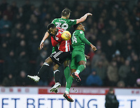 Preston's Billy Bodin and Darnell Fisher battle in the air with Brentford's Florian Jozefzoon<br /> <br /> Photographer Jonathan Hobley/CameraSport<br /> <br /> The EFL Sky Bet Championship - Brentford v Preston North End - Saturday 10th February 2018 - Griffin Park - Brentford<br /> <br /> World Copyright &copy; 2018 CameraSport. All rights reserved. 43 Linden Ave. Countesthorpe. Leicester. England. LE8 5PG - Tel: +44 (0) 116 277 4147 - admin@camerasport.com - www.camerasport.com