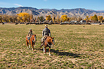 Cowboys Nick Dowers and son Crue, checking the cattle at the ranch in Dyer, Nevada