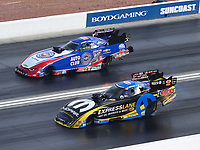 Oct 29, 2016; Las Vegas, NV, USA; NHRA funny car driver Matt Hagan (near) races alongside Robert Hight during qualifying for the Toyota Nationals at The Strip at Las Vegas Motor Speedway. Mandatory Credit: Mark J. Rebilas-USA TODAY Sports