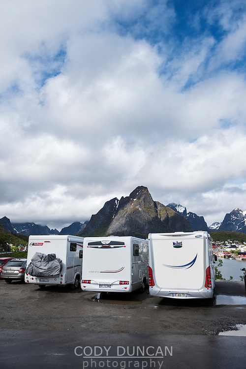Motorhomes fill parking lot in summer, Reine, Moskenesøy, Lofoten Islands, Norway