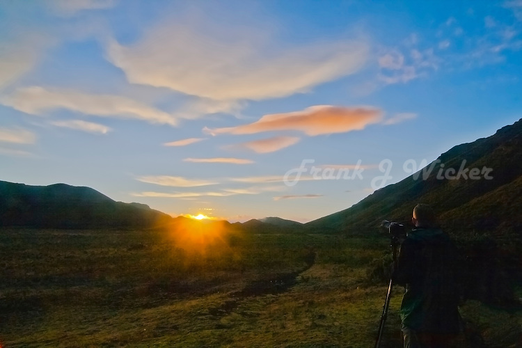 Lone male photographer at sunrise inside the crater of HALEAKALA NATIONAL PARK on Maui in Hawaii USA