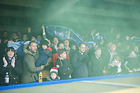 Fans let off a smoke flare during the Sky Bet League 2 match between AFC Wimbledon and Wycombe Wanderers at the Cherry Red Records Stadium, Kingston, England on 21 November 2015. Photo by Alan  Stanford/PRiME.