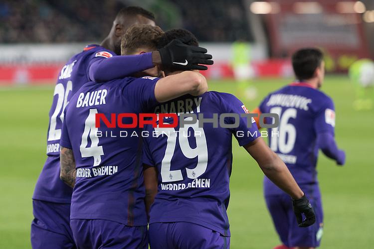 24.02.2017, Volkswagen Arena, Wolfsburg, GER, 1.FBL, VFL Wolfsburg vs Werder Bremen, im Bild<br /> <br /> Jubel nach dem 0 zu 1 durch  Serge Gnabry (Bremen #29)<br /> mit Robert Bauer (Bremen #4)<br /> Lamine San&eacute; / Sane (Bremen #26)<br /> <br /> Rueckansicht<br /> <br /> Foto &copy; nordphoto / Kokenge