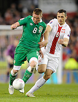 29th March 2015; UEFA EURO 2016 Championship Qualifier Group D, Ireland vs Poland, Aviva Stadium, Dublin<br /> Republic of Ireland's James McCarthy with Tomasz Jodlowiec of Poland.<br /> Picture credit: Tommy Grealy/actionshots.ie.