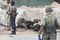 The remains of a car bomb stand in front of Parliament House in Mogadishu during a seige by al-Shabaab militants as they took control of the building before mbeing killed by Somali National Army and AMISOM troops.