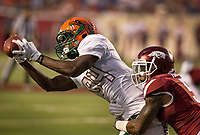 Hawgs Illustrated/BEN GOFF <br /> Henre' Toliver, Arkansas cornerback, tackles Chad Hunter (84), of Florida A&M as he catches a pass in the first quarter Thursday, Aug. 31, 2017, during the game at War Memorial Stadium in Little Rock.