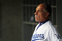 Davey Lopes #12, first base coach of the Los Angeles Dodgers, in the dugout during game against the Milwaukee Brewers at Dodger Stadium in Los Angeles,California on May 16, 2011. Photo by Larry Goren/Four Seam Images