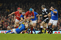 Wales Justin Tipuric is tackled by Italy&rsquo;s Marcello Violi<br /> <br /> Photographer Ian Cook/CameraSport<br /> <br /> 2018 NatWest Six Nations Championship - Wales v Italy - Sunday 11th March 2018 - Principality Stadium - Cardiff<br /> <br /> World Copyright &copy; 2018 CameraSport. All rights reserved. 43 Linden Ave. Countesthorpe. Leicester. England. LE8 5PG - Tel: +44 (0) 116 277 4147 - admin@camerasport.com - www.camerasport.com