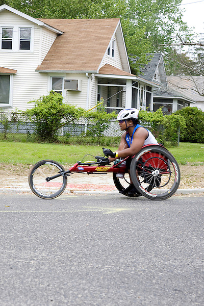 Minda on her racing wheelchair during the running leg of the New Jersey Devilman Triathlon on May 5, 2012 in Cumberland County, New Jersey.
