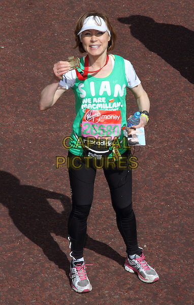 Sian Williams.London Marathon 2013 - Picture coverage at the start and finish plus presentations, London, England..April 21st 2013.full length exercise green top black spandex hat visor hat white medal winner .CAP/ROS.©Steve Ross/Capital Pictures