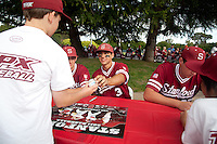 STANFORD, CA - April 23, 2011: Kenny Diekroeger of Stanford baseball hands a signed ball to a fan after Stanford's game against UCLA at Sunken Diamond. Stanford won 5-4.