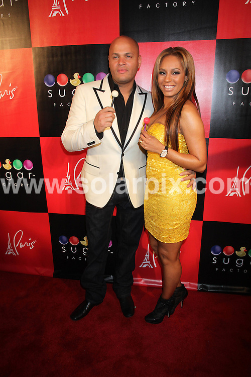 **ALL ROUND PICTURES FROM SOLARPIX.COM**                                             **SYNDICATION RIGHTS FOR UK, AUSTRALIA, DENMARK, PORTUGAL, S. AFRICA, SPAIN & DUBAI (U.A.E) & ASIA (EXCLUDING JAPAN) ONLY**                                                                                  Caption: Sugar Factory American Brasserie Grand Opening at Paris Las Vegas NV, USA                                                                              .This pic: Stephen Belafonte, Melanie Brown                                                                                            JOB REF: 12919       PHZ       DATE:  04.03.2011                                                          **MUST CREDIT SOLARPIX.COM OR DOUBLE FEE WILL BE CHARGED**                                                                      **MUST AGREE FEE BEFORE ONLINE USAGE**                               **CALL US ON: +34 952 811 768 or LOW RATE FROM UK 0844 617 7637**