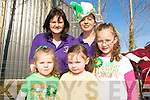 FUN: Having fun in the sun at the St Patrick's Day Parade in Milltown, front l-r: Caitlin Harper, Kaya Sayers, Saoirse Harper. Back l-r: Eileen Courtney, Christina Harper, all of Castlemaine Childcare.