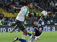 BOGOTA - COLOMBIA, 22-09-2018: Ayron del Valle (Der) jugador de Millonarios disputa el balón con Diego Peralta (Izq) jugador de Once Caldas durante partido por la fecha 11 de la Liga Águila II 2018 jugado en el estadio Nemesio Camacho El Campin de la ciudad de Bogotá. / Ayron del Valle (R) player of Millonarios fights for the ball with Diego Peralta (L) player of Once Caldas during the match for the date 11 of the Liga Aguila II 2018 played at the Nemesio Camacho El Campin Stadium in Bogota city. Photo: VizzorImage / Gabriel Aponte / Staff.