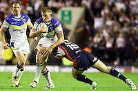 PICTURE BY ALEX WHITEHEAD/SWPIX.COM - Rugby League - Super League Play-Off - Warrington Wolves vs St Helens - The Halliwell Jones Stadium, Warrington, England - 15/09/12 - Warrington's Mike Cooper is tackled by St Helens' Andrew Dixon.