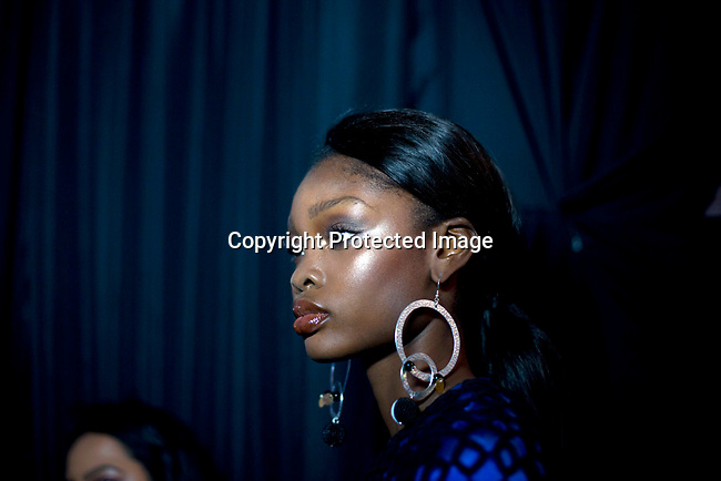 JOHANNESBURG, SOUTH AFRICA OCTOBER 31: A model walking for the designer label Kiki Romeo from Kenya has her makeup done backstage before a show at Mercedes Benz Africa fashion week Africa on October 31, 2014 held at Melrose Arch in Johannesburg, South Africa. Designers from all over Africa showed their best collections at the yearly event. (Photo by: Per-Anders Pettersson)