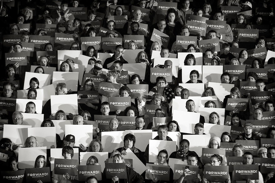 "Members of the audience make and an ""O"" during a campaign rally with President Barack Obama in Mentor,  OH."