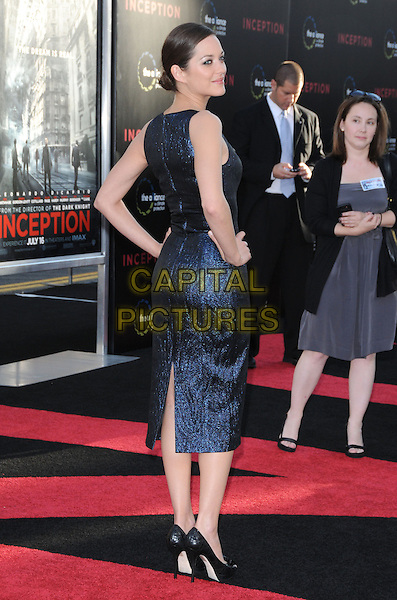 MARION COTILLARD .at the Warner Bros. Film Premiere of 'Inception' held at The Grauman's Chinese Theatre in Hollywood, California, USA, July 13th 2010..full length dress blue shiny navy sleeveless back rear behind looking over shoulder bun profile hands on hips shoes heels .CAP/RKE/DVS.©DVS/RockinExposures/Capital Pictures.
