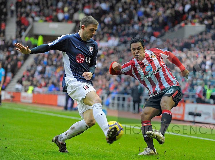 Sunderland's Kieran Richardson and Fulham's Chris Baird.