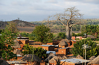 ANGOLA, Cuanza Sul, Cachoeiras do Rio Keve, village with clay huts and Baobab tree