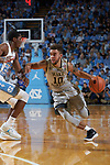 Mitchell Wilbekin (10) of the Wake Forest Demon Deacons dribbles past Kenny Williams (24) of the North Carolina Tar Heels during first half action at the Dean Smith Center on December 30, 2017 in Chapel Hill, North Carolina.  The Tar Heels defeated the Demon Deacons 73-69.  (Brian Westerholt/Sports On Film)