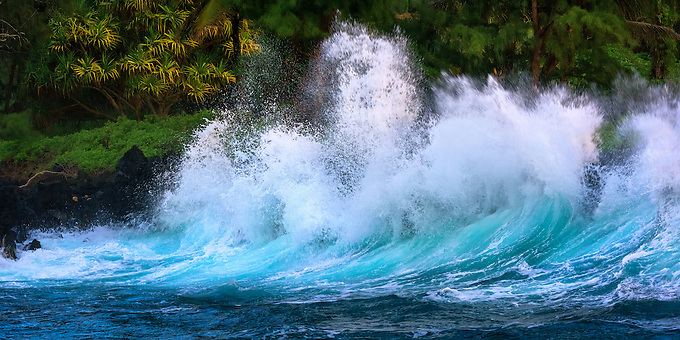 Crashing waves onto the rocky shores of Ke'Anae Point in northern Maui.