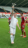Pictured: Adam Woodyatt from Eastenders with the winning trophy after the end of the game. Sunday, 01 June 2014<br /> Re: Celebrities v Celebrities football game organised by Sellebrity Scoccer, in aid of Swansea City Community Trust, at the Liberty Stadium, south Wales.