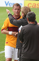 Steven Hammell being praised by Manager Stuart McCall in the Motherwell v Everton friendly match at Fir Park, Motherwell on 21.7.12 for Steven Hammell's Testimonial.